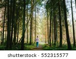 woman walking in a pine tree... | Shutterstock . vector #552315577