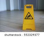 yellow sign that alerts for wet ... | Shutterstock . vector #552329377