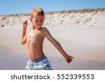 boy playing and jumping in the... | Shutterstock . vector #552339553
