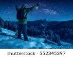 hiker standing with raised... | Shutterstock . vector #552345397