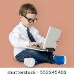 boy studio shoot gesture... | Shutterstock . vector #552345403