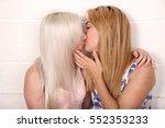 a pair of blonde same sex... | Shutterstock . vector #552353233