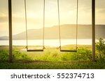 children swing in the park | Shutterstock . vector #552374713