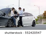 Small photo of Woman driver calls for instruction during insurance agent review the dammage of the car after accident