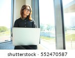 hipster girl use laptop huge... | Shutterstock . vector #552470587