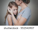 sad daughter hugging his mother ... | Shutterstock . vector #552543907
