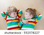 two little sibling kid boys... | Shutterstock . vector #552578227