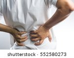 a man with back pain on white... | Shutterstock . vector #552580273