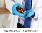 male doctor with blue gloves... | Shutterstock . vector #552604087