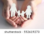 Small photo of Child and adult person holding figure in shape of happy family, closeup. Adoption concept