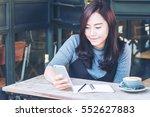 a beautiful asian woman using... | Shutterstock . vector #552627883