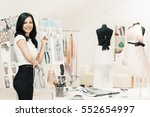 a fashion designer sorting out... | Shutterstock . vector #552654997