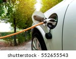 charging an electric car with... | Shutterstock . vector #552655543