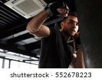 sportsman trains in boxing... | Shutterstock . vector #552678223