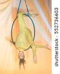 Small photo of Acrobatic artist face down on the hoop, on stage