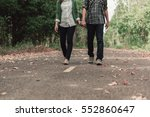 young couple holding hands and... | Shutterstock . vector #552860647