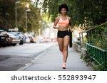 healthy sportswoman running on... | Shutterstock . vector #552893947
