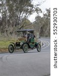 Small photo of Adelaide, Australia - September 25, 2016: Vintage 1912 Ford T Runabout driving on country roads near the town of Birdwood, South Australia.