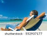man relaxing on beach  tropical