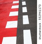 Red And White Road Marking On...