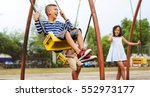 Asian Children Enjoy Swing