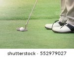 golf player put a golf ball on... | Shutterstock . vector #552979027
