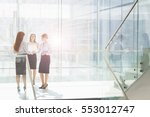 businesswomen talking in office | Shutterstock . vector #553012747