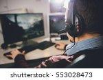man wearing headphones and... | Shutterstock . vector #553028473