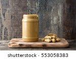 Peanut Butter Jar On Wooden...