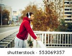 man resting on the bridge after ... | Shutterstock . vector #553069357