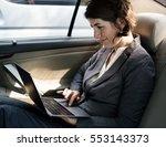 businesswoman working using... | Shutterstock . vector #553143373