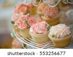 rose cupcakes on the shelf.... | Shutterstock . vector #553256677
