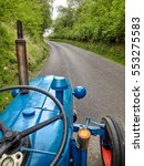 Driving A Blue Tractor On A...