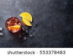 negroni cocktail on dark stone... | Shutterstock . vector #553378483