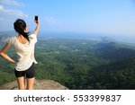 young asian woman taking photo... | Shutterstock . vector #553399837