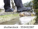 a man with shoe snow spikes in... | Shutterstock . vector #553432387