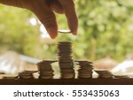 hand stacking of coins concept... | Shutterstock . vector #553435063