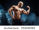 strong bald bodybuilder with... | Shutterstock . vector #553440583