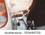 woman refueling car with diesel ...
