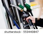 woman holding diesel fuel...