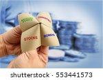 man uses a paper fortune teller ... | Shutterstock . vector #553441573