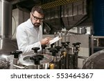 serious man noting work results ... | Shutterstock . vector #553464367