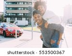 young multiethnic couple... | Shutterstock . vector #553500367