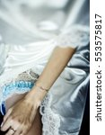 bride holds her thin hand on... | Shutterstock . vector #553575817