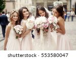 beautiful bride and bridesmiads ... | Shutterstock . vector #553580047