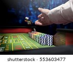 Small photo of dices throw on craps table at casino