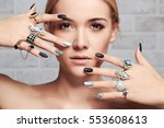 beauty face.woman's hands with jewelry rings.close-up beauty and fashion portrait. girl make-up and manicure