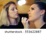 makeup artist applies mascara.... | Shutterstock . vector #553622887