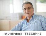 portrait of senior man in office | Shutterstock . vector #553625443