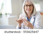 senior female doctor giving...   Shutterstock . vector #553625647